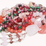heap of red and pink colored beads